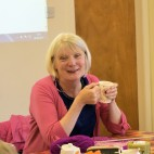 Linda at Knitters and Stitchers group enjoys a cup of tea, September 2015.